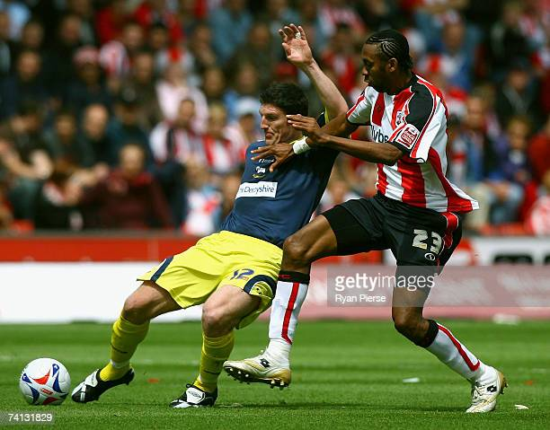 Jhon Viafara of Southampton tackles Jonathan Macken of Derby County during the Coca Cola Championship Playoff SemiFinal First Leg match between...