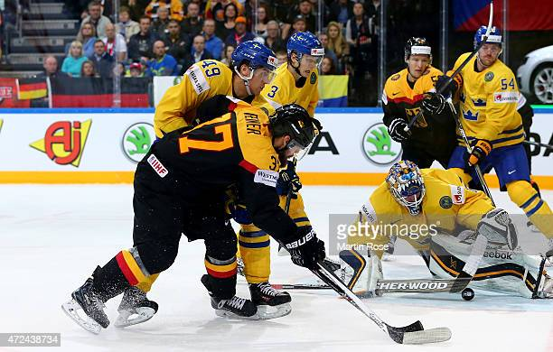 Jhonas Enroth goaltender of Sweden saves the shot of Patrick Reimer of Germany during the IIHF World Championship group A match between Sweden and...