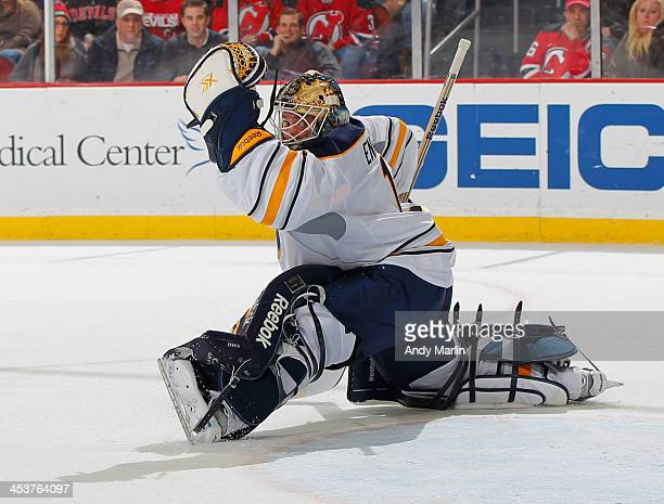 Jhonas Enroth of the Buffalo Sabres defends his net against the New Jersey Devils during the game at the Prudential Center on November 30 2013 in...