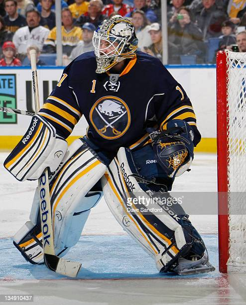 Jhonas Enroth of the Buffalo Sabres keeps an eye on play against the Washington Capitals during their NHL game at First Niagara Center on November 26...