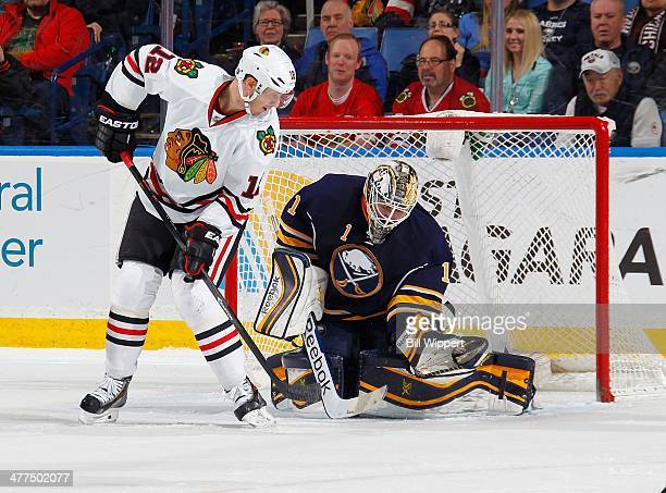 Jhonas Enroth of the Buffalo Sabres makes a save on a deflection by Peter Regin of the Chicago Blackhawks on March 9, 2014 at the First Niagara...