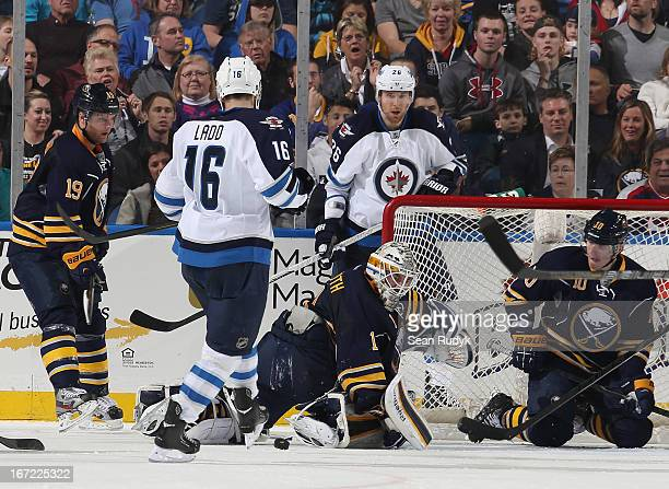 Jhonas Enroth of the Buffalo Sabres makes a second period save as teammate Christian Ehrhoff defends the net alongside Andrew Ladd and Blake Wheeler...