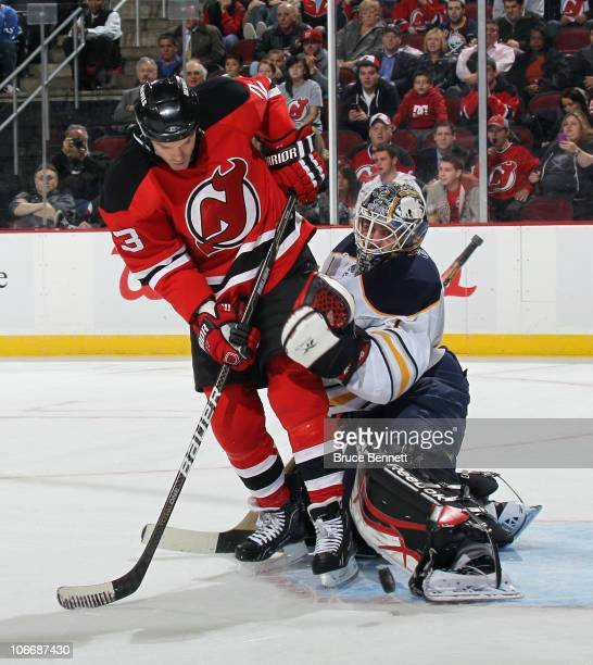 Jhonas Enroth of the Buffalo Sabres makes the kick save against David Clarkson of the New Jersey Devils at the Prudential Center on November 10 2010...