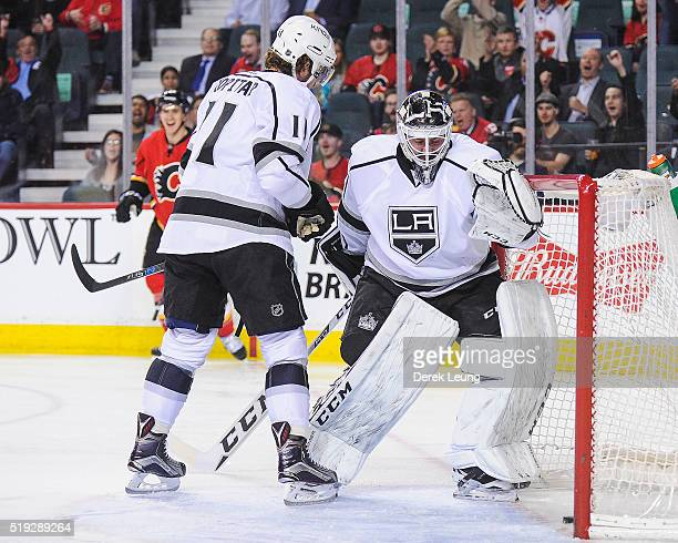 Jhonas Enroth of the Los Angeles Kings allows a shot from Mikael Backlund of the Calgary Flames during an NHL game at Scotiabank Saddledome on April...