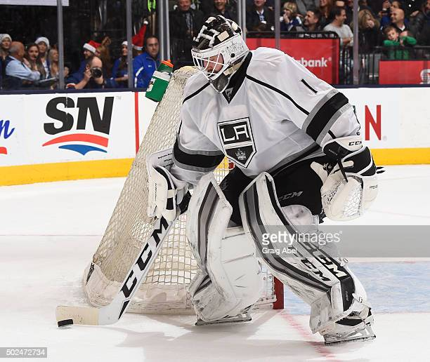 Jhonas Enroth of the Los Angeles Kings controls the puck against the Toronto Maple Leafs during game action on December 19 2015 at Air Canada Centre...