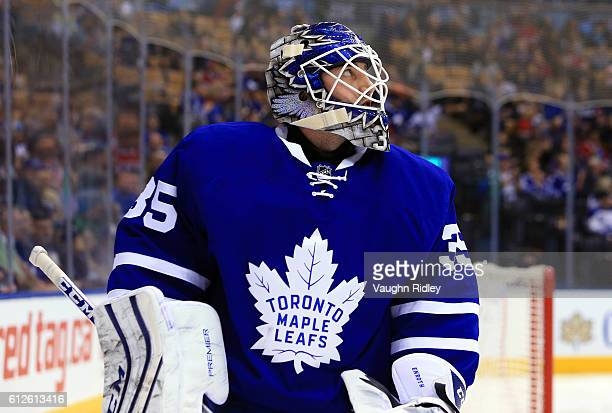 Jhonas Enroth of the Toronto Maple Leafs looks to the scoreboard during an NHL preseason game against the Montreal Canadiens at Air Canada Centre on...