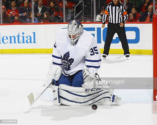 Jhonas Enroth of the Toronto Maple Leafs makes a save against the New Jersey Devils during the game at Prudential Center on November 23 2016 in...