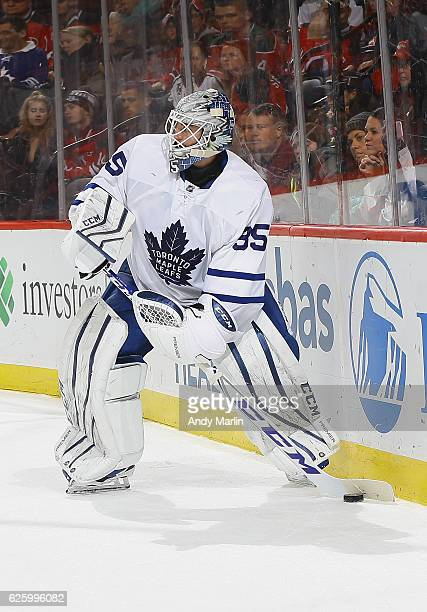 Jhonas Enroth of the Toronto Maple Leafs plays the puck against the New Jersey Devils during the game at Prudential Center on November 23 2016 in...