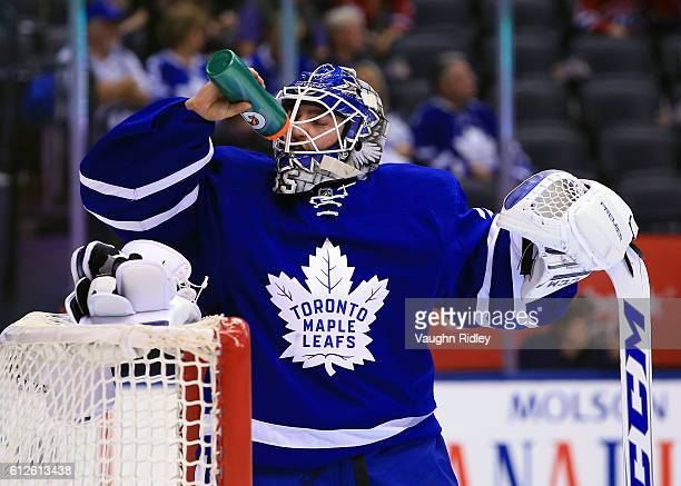 Jhonas Enroth of the Toronto Maple Leafs takes a drink during an NHL preseason game against the Montreal Canadiens at Air Canada Centre on October 2...