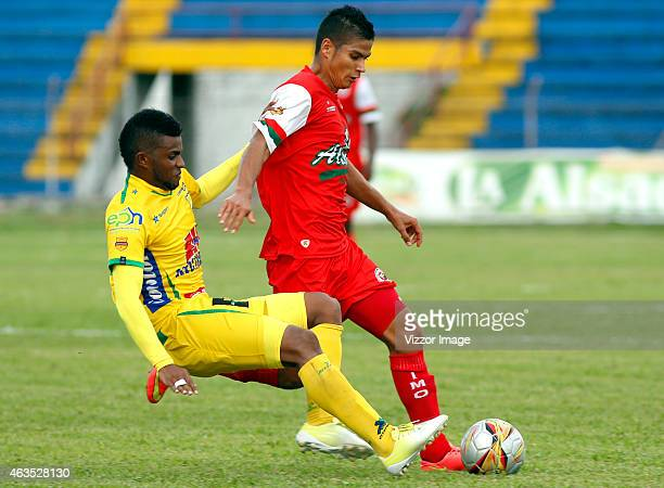 Jhonatan Muñoz of Cortulua struggles for the ball with Jhonny Cano of Atletico Huila during a match between Cortulua and Atletico Huila as part of...
