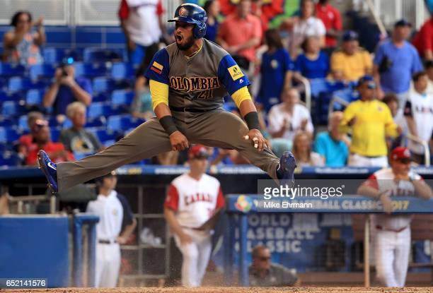 Jhonatan Solano of Colombia reacts to scoring a run in during the third inning during a Pool C game of the 2017 World Baseball Classic against Canada...