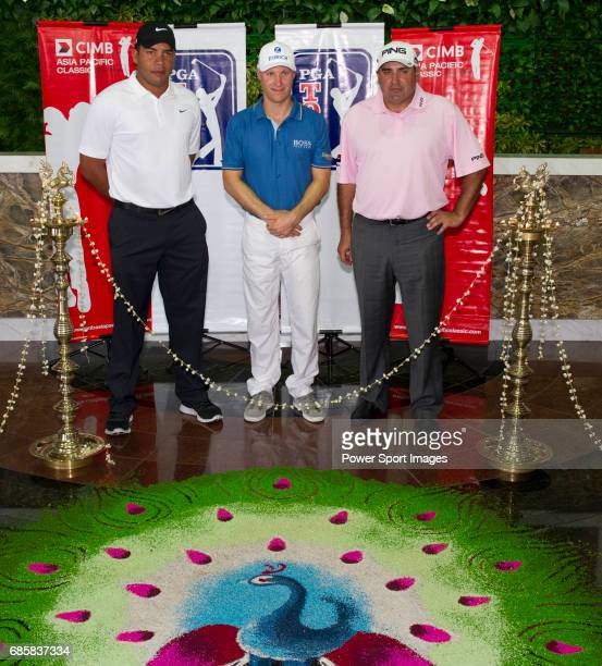 Jhonattan Vegas Ben Crane and Angel Cabrera complete the Deepavali Kolam to mark the opening of the CIMB Asia Pacific Classic 2011 at the MINES...