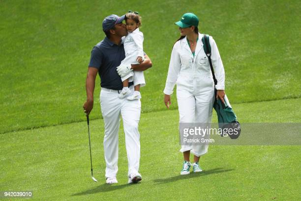 Jhonattan Vegas of Columbia walks with wife Hildegard Struppek and daughter Sharlene during the Par 3 Contest prior to the start of the 2018 Masters...