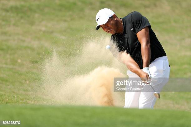 Jhonattan Vegas of Venezuela plays a shot out of a bunker on the 16th hole of his match during round one of the World Golf ChampionshipsDell...