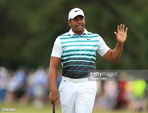 Jhonattan Vegas of Venezuela reacts after making his birdie putt on the 18th green during the final round of the RBC Canadian Open at Glen Abbey Golf...