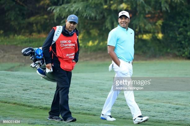 Jhonattan Vegas of Venezuela walks with caddie Ruben Yorio during the proam prior to the WGC HSBC Champions at Sheshan International Golf Club on...