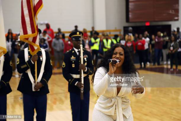 Jhonni Blaze sings the national anthem at the Chad Ochocinco Celebrity Super Slam Charity Basketball Game at Forbes Arena at Morehouse College on...