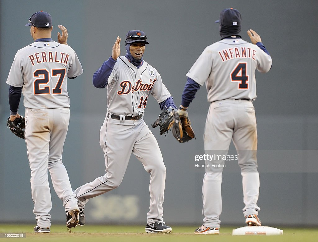 Jhonny Peralta #27, Austin Jackson #14 andOmar Infante #4 of the Detroit Tigers celebrate a win of the Opening Day game against the Minnesota Twins on April 1, 2013 at Target Field in Minneapolis, Minnesota. The Tigers defeated the Twins 4-2.