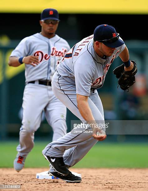 Jhonny Peralta of the Detroit Tigers barehands the ball and throws toward first as Ramon Santiago runs to cover second during the game at Kauffman...