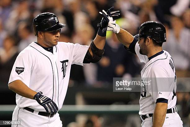 Jhonny Peralta of the Detroit Tigers celebrates after hitting a solo home run with Alex Avila in the sixth inning of Game Three of the American...