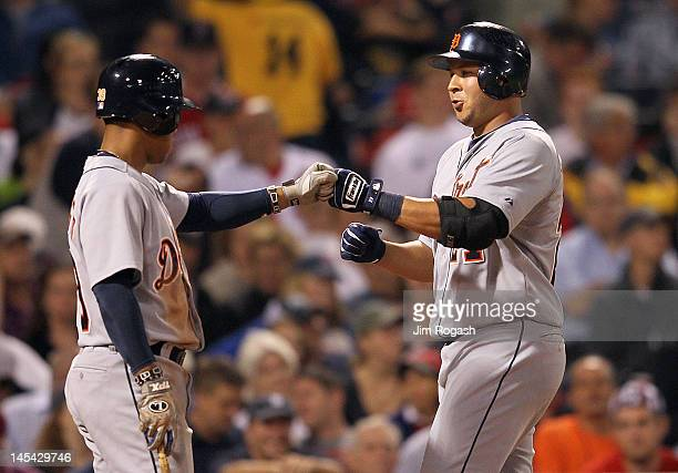 Jhonny Peralta of the Detroit Tigers celebrates his home run with teammate Ramon Santiago against the Boston Red Sox in the fifth inning at Fenway...