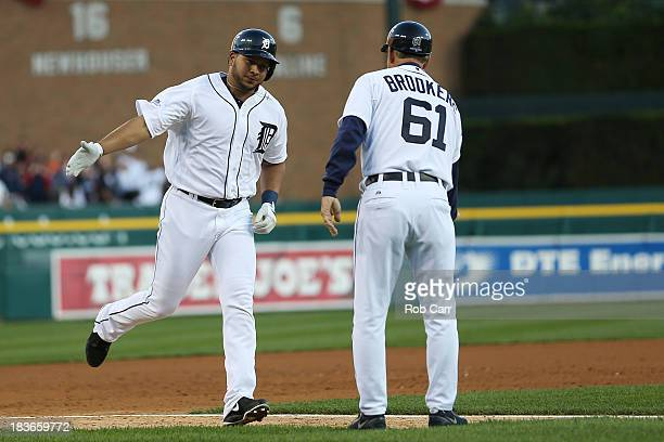 Jhonny Peralta of the Detroit Tigers celebrates his three run home run in the fifth inning with third base coach Tom Brookens as he runs the bases...