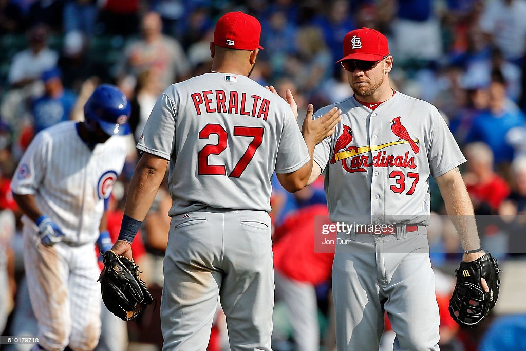Jhonny Peralta #27 of the St. Louis Cardinals and Brandon Moss #37 celebrate their win against the Chicago Cubs at Wrigley Field on September 24, 2016 in Chicago, Illinois. The St. Louis Cardinals won 10-4.