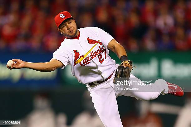 Jhonny Peralta of the St Louis Cardinals attempts to throw a runner out in the seventh inning against the Chicago Cubs during game one of the...