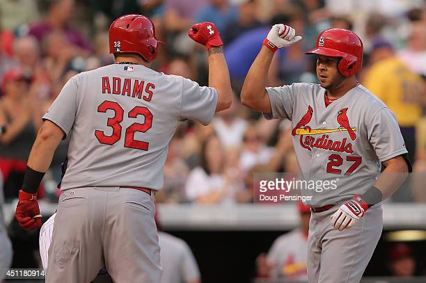 Jhonny Peralta of the St. Louis Cardinals celebrates his two run home run off of starting pitcher Jorge De La Rosa of the Colorado Rockies with Matt...