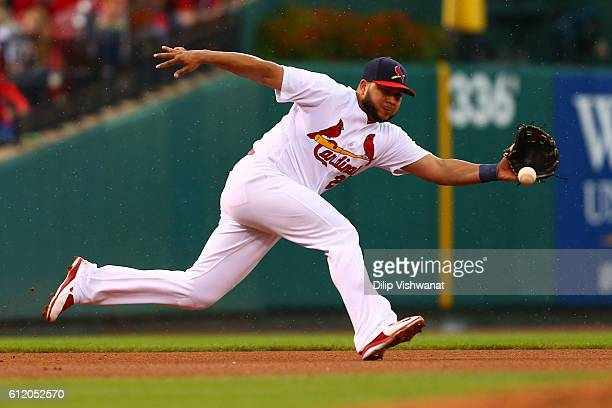 Jhonny Peralta of the St Louis Cardinals fields a ground ball against the Pittsburgh Pirates in the fourth inning at Busch Stadium on October 2 2016...