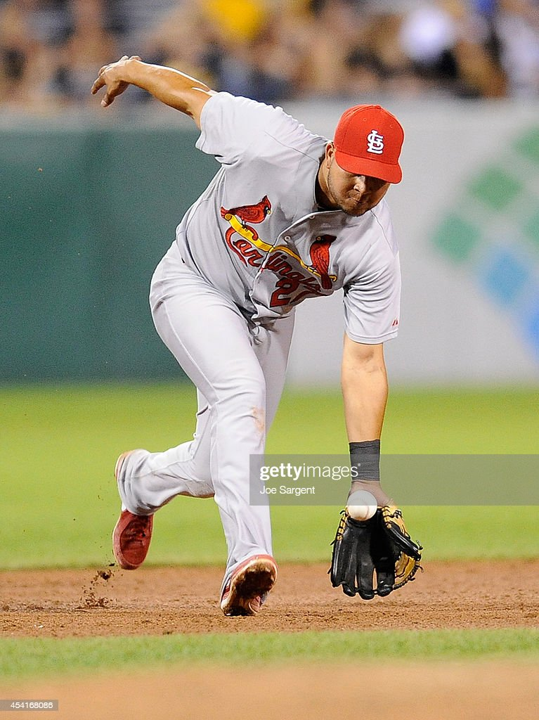 Jhonny Peralta #27 of the St. Louis Cardinals fields a ground ball during the eighth inning against the Pittsburgh Pirates on August 25, 2014 at PNC Park in Pittsburgh, Pennsylvania.