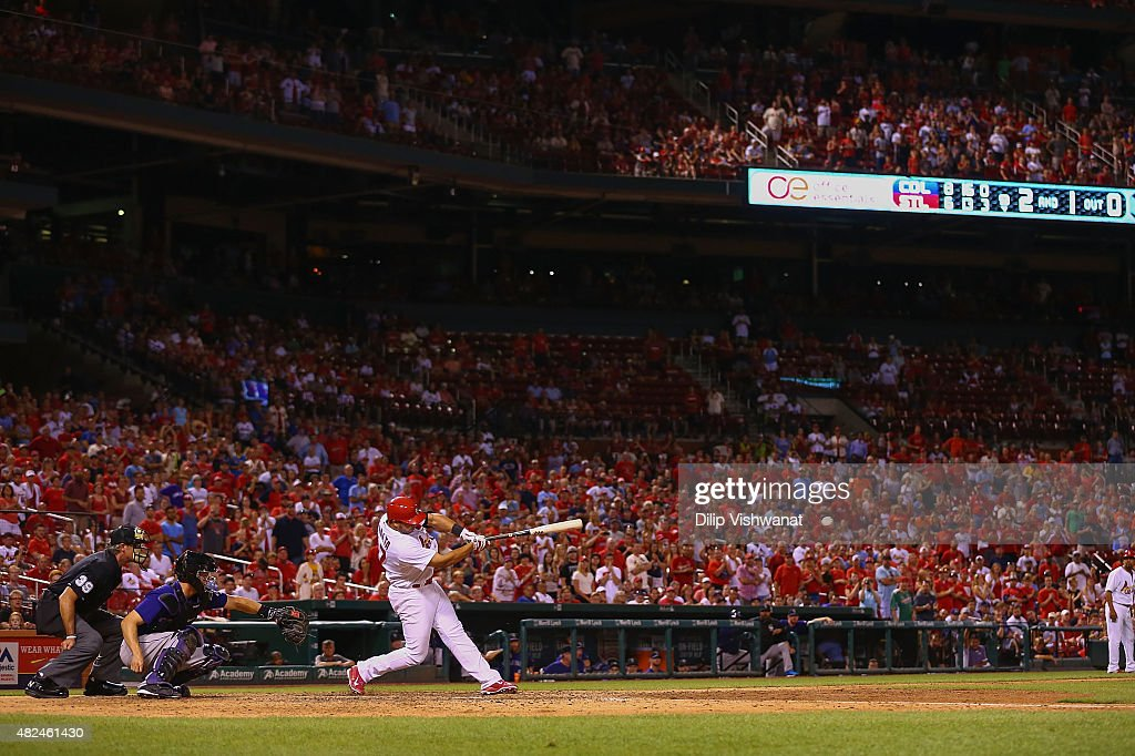 Jhonny Peralta #27 of the St. Louis Cardinals hits a game-tying RBI single against the Colorado Rockies in the ninth inning at Busch Stadium on July 30, 2015 in St. Louis, Missouri.