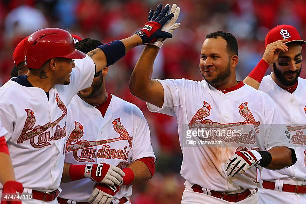 Jhonny Peralta of the St Louis Cardinals is congratulated by teammates after hitting a walkoff solo home run against Arizona Diamondbacks in the...