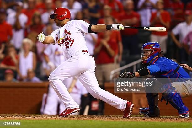 Jhonny Peralta of the St Louis Cardinals puts the ball in play to win the game on a throwing error in the tenth inning against the Chicago Cubs at...