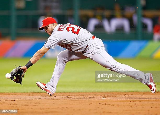 Jhonny Peralta of the St Louis Cardinals reaches but comes up short on a ground ball single in the third inning against the Pittsburgh Pirates during...
