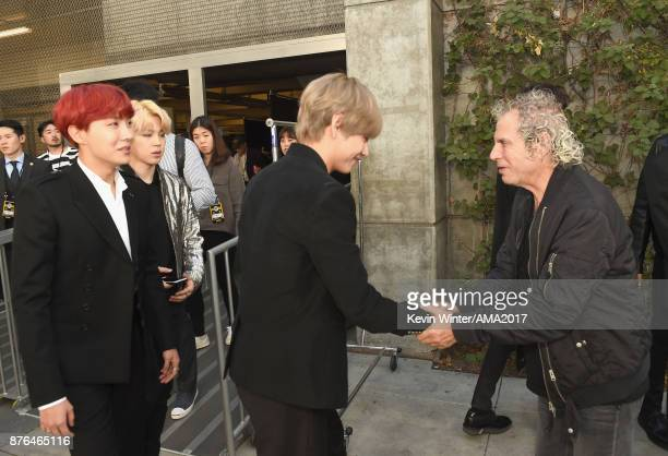 JHope Jimin and V of music group BTS greet American Music Awards producer Larry Klein during the 2017 American Music Awards at Microsoft Theater on...