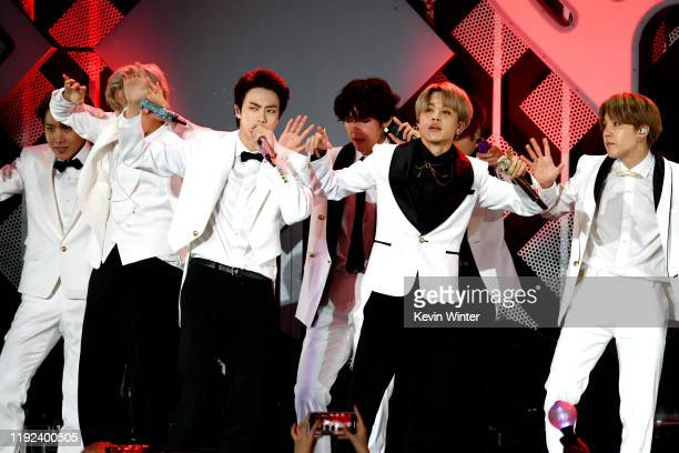 JHope Suga Jin V Jimin and Suga of BTS perform onstage during 1027 KIIS FM's Jingle Ball 2019 Presented by Capital One at the Forum on December 6...