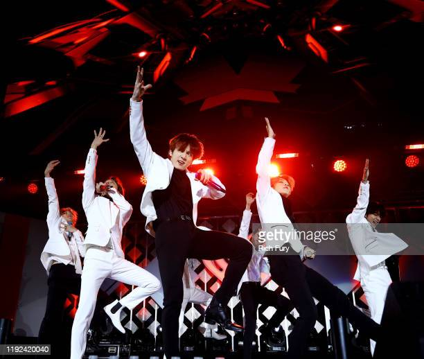 Hope, Suga , Jung Kook , Jin , Jimin, V. Of BTS perform onstage during 102.7 KIIS FM's Jingle Ball 2019 Presented by Capital One at the Forum on...