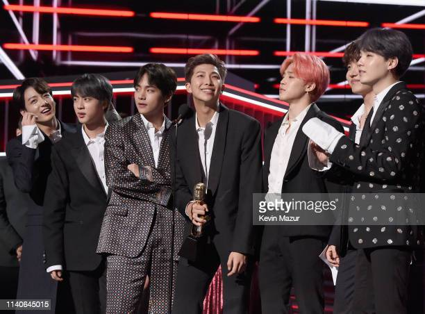 Hope, V, Jungkook, Jimin, Suga, Jin, and RM of BTS accept Top Duo/Group onstage during the 2019 Billboard Music Awards at MGM Grand Garden Arena on...