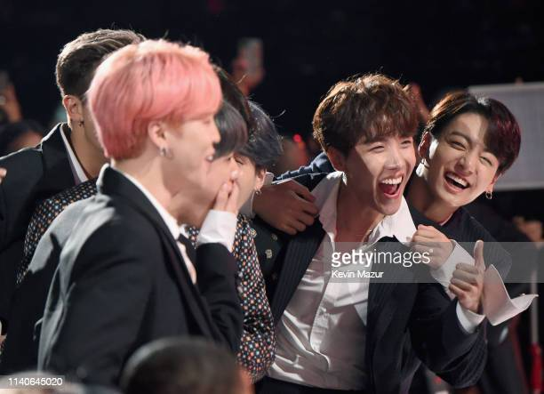 Hope V Jungkook Jimin Suga Jin and RM of BTS accept Top Duo/Group onstage during the 2019 Billboard Music Awards at MGM Grand Garden Arena on May 1...