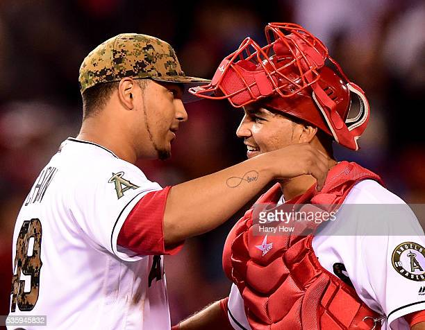 Jhoulys Chacin of the Los Angeles Angels celebrates a 51 wn over the Detroit Tigers with Carlos Perez at Angel Stadium of Anaheim on May 30 2016 in...
