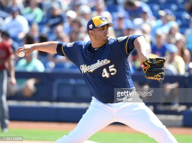 Jhoulys Chacin of the Milwaukee Brewers delivers a pitch against the Arizona Diamondbacks during the first inning of a spring training game at...