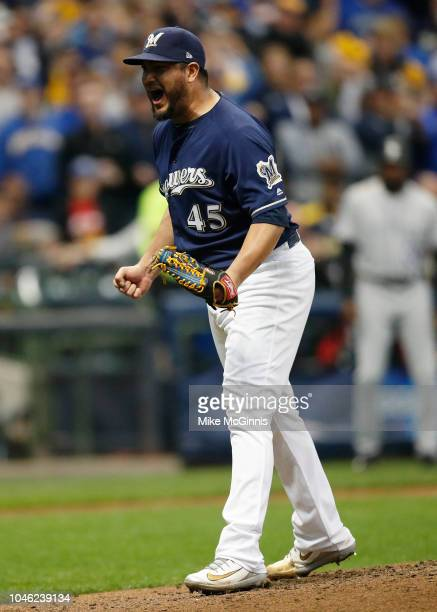 Jhoulys Chacin of the Milwaukee Brewers reacts after striking out Nolan Arenado of the Colorado Rockies to end the top of the fifth inning during...