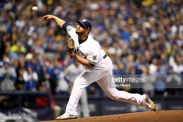 Jhoulys Chacin of the Milwaukee Brewers throws a pitch against the Los Angeles Dodgers during the first inning in Game Seven of the National League...