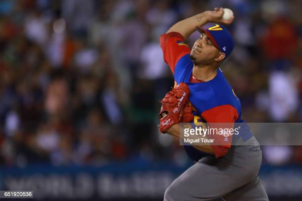 Jhoulys Chacin of Venezuela pitches in the bottom of the sixth inning during the World Baseball Classic Pool D Game 2 between Venezuela and Puerto...