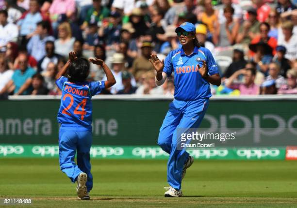 Jhulan Goswami is congratulated by teammate Poonam Yadev after taking a catch during the ICC Women's World Cup 2017 Final between England and India...