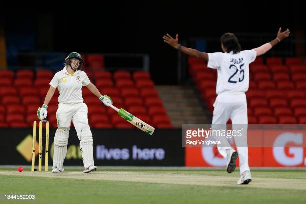 Jhulan Goswami of India celebrates taking the wicket of Alyssa Healy of Australia during day four of the Women's International Test Match between...