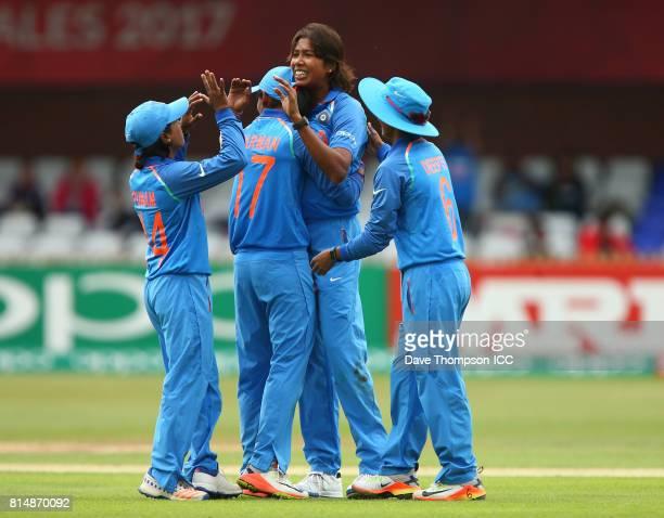 Jhulan Goswami of India celebrates taking the wicket of Rachel Priest of New Zealand with team mates Punham Raut of India Harmanpreet Kaur of India...