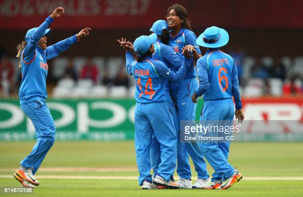 Jhulan Goswami of India celebrates taking the wicket of Rachel Priest of New Zealand with team mates fro left to right Veda Krishnamurthy of India...