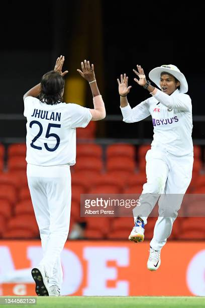 Jhulan Goswami of India celebrates with team mate Deepti Sharma after bowling out Alyssa Healy of Australia during day four of the Women's...